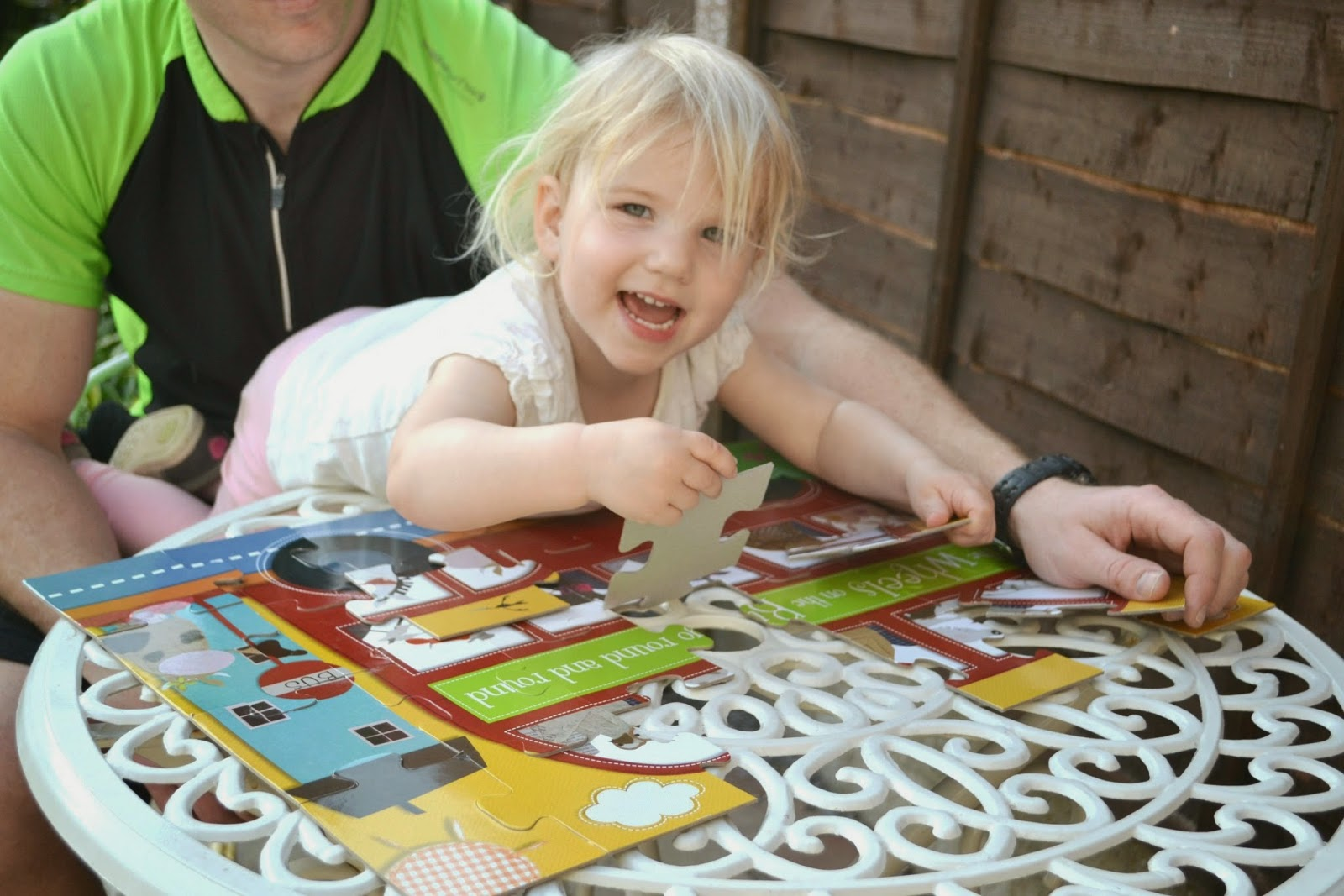 Tin Box Tot playing with a jigsaw puzzle