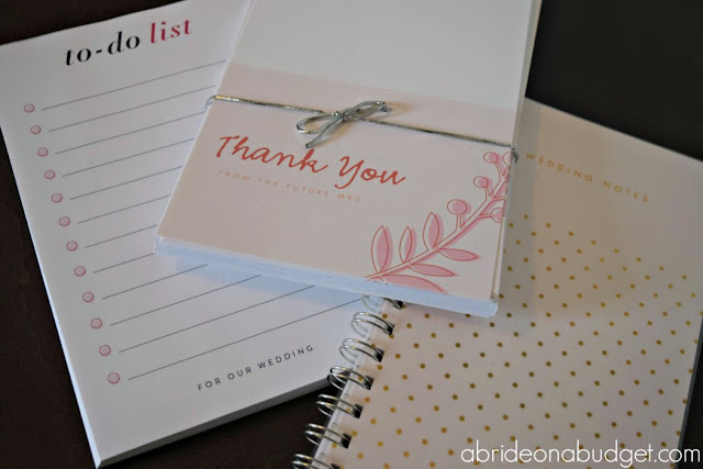 Wondering what to buy your newly engaged friend? A Bride On A Budget curated a Wedding Planning Survival Kit at www.abrideonabudget.com. She personalized all the items for a new bride-to-be too, so that will help you when you're deciding what to write on your gift!