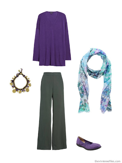 wearing an ultraviolet sweater with green pants