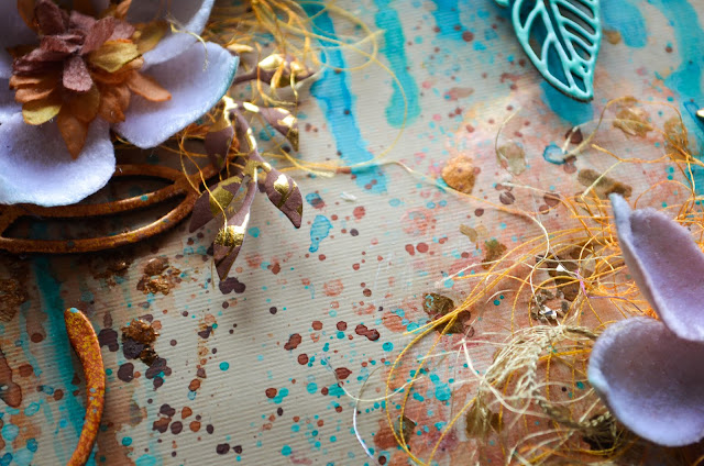 Mixed media scrapbook layout in turquoise, aqua, copper, and bronze with chipboard frame and feathers with texture paste, watercolors, paint splatters, glimmer mist, mica flakes, die cut foliage, and Petaloo velvet magnolias