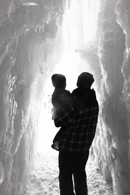 Father and son in an ice castle