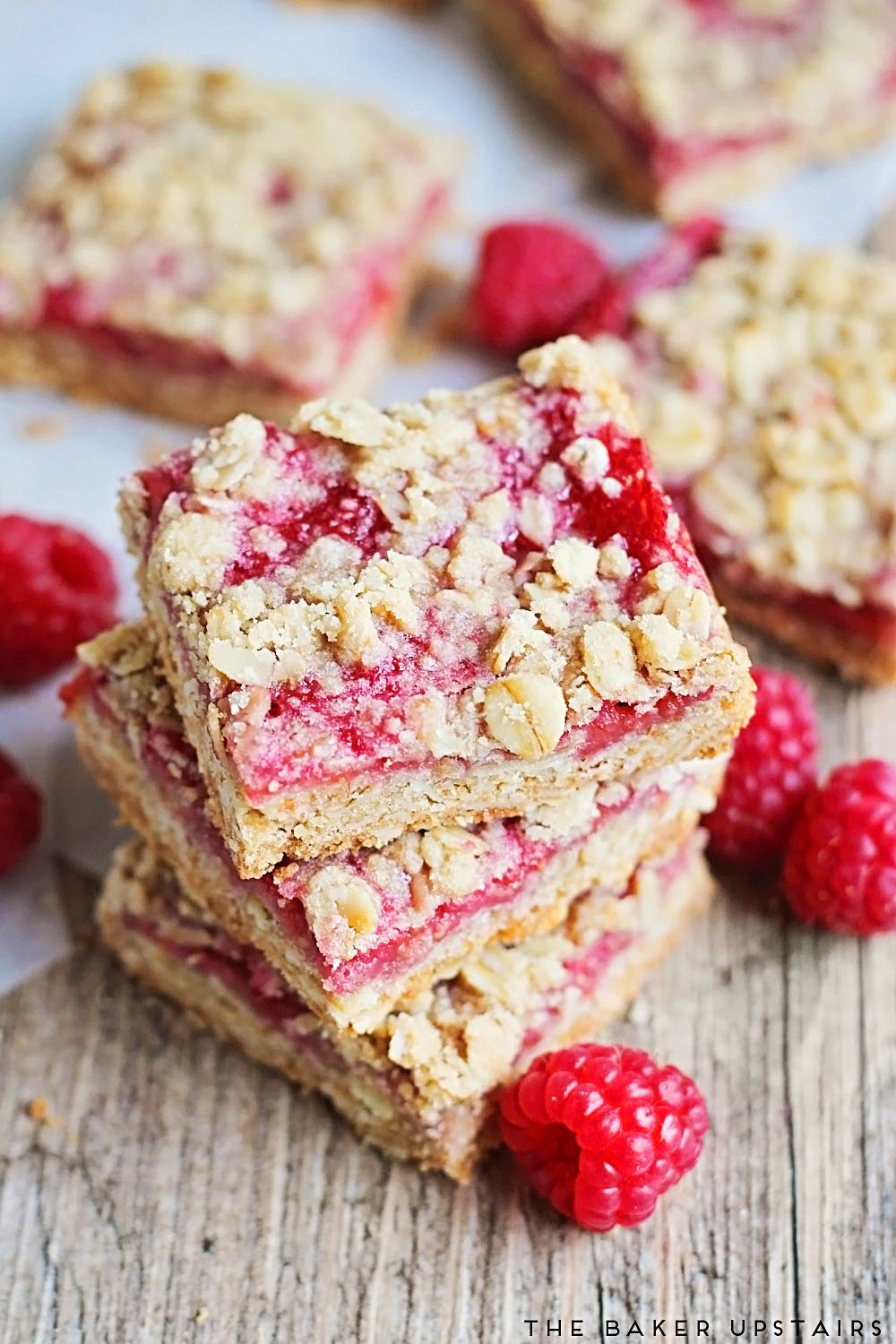 These raspberry crumb bars are amazing! A buttery oatmeal crumb base combined with fresh raspberry jam makes for a delicious cookie bar.
