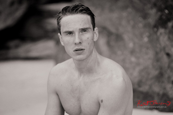 Black and White portrait on the beach for a male modelling portfolio - Photographed by Kent Johnson, Sydney, Australia.