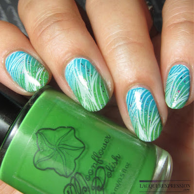 Green and turquoise ombre with white stamping nail art for Earth day manicure