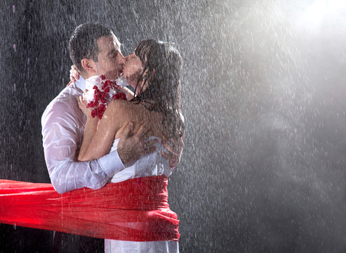Romantic Couple Kissing In Rain