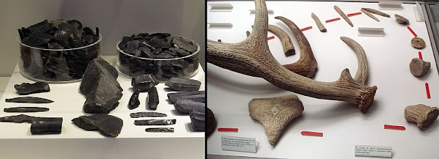 Obsidian in different forms on the left. The long narrow small pieces are sharp blades, sharper than today's stainless steel. On the right is an antler. Bone tools were used to shape obsidian in a precise manner.