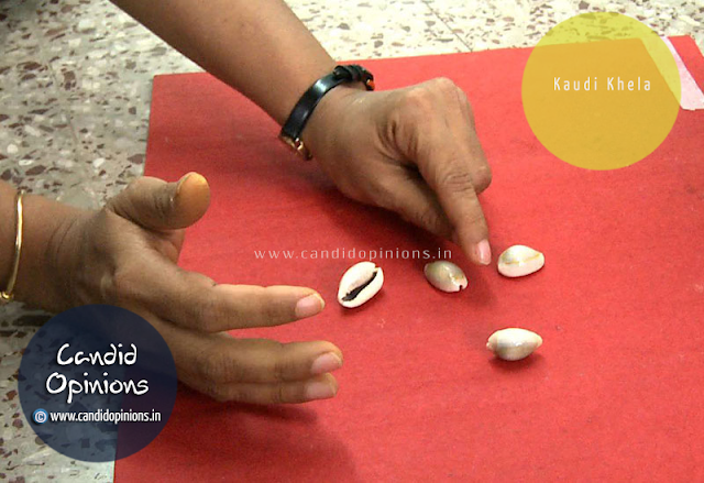 Kaudi Khela - the game of cowrie shells played during Raja festival
