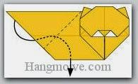 Bước 13: Gấp cạnh giấy vào trong giữa hai lớp giấy.