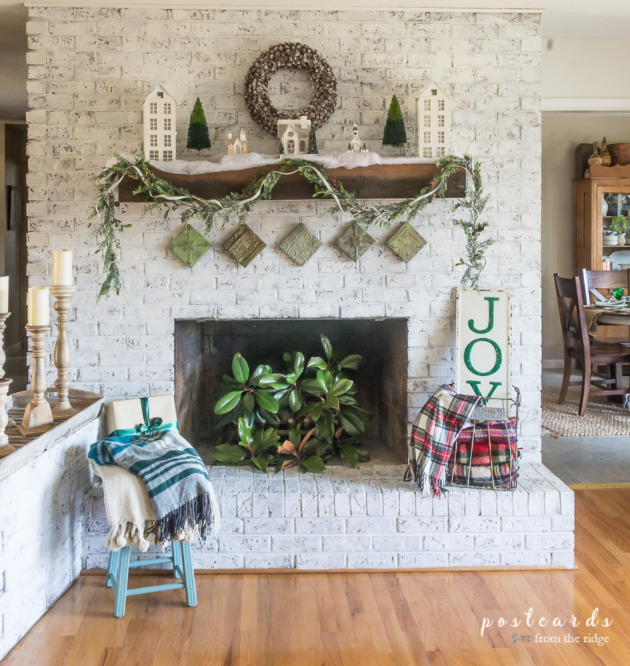 white painted brick farmhouse Christmas mantel decor