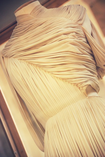 Closeup photo of the detailing on a cream colored Madame Gres design