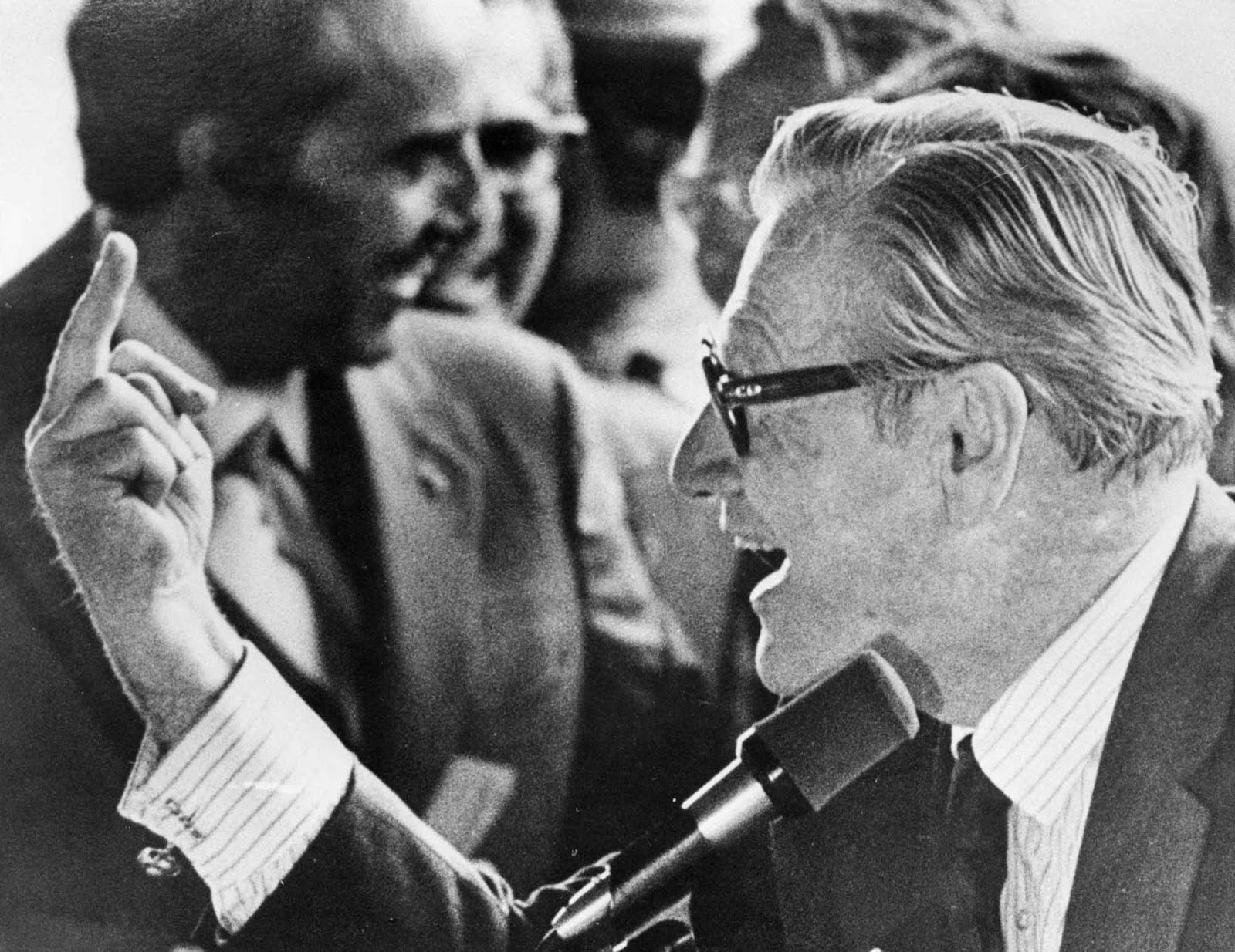 Vice President Nelson Rockefeller flips off a crowd of young hecklers, Binghamton, NY, September 16, 1976.