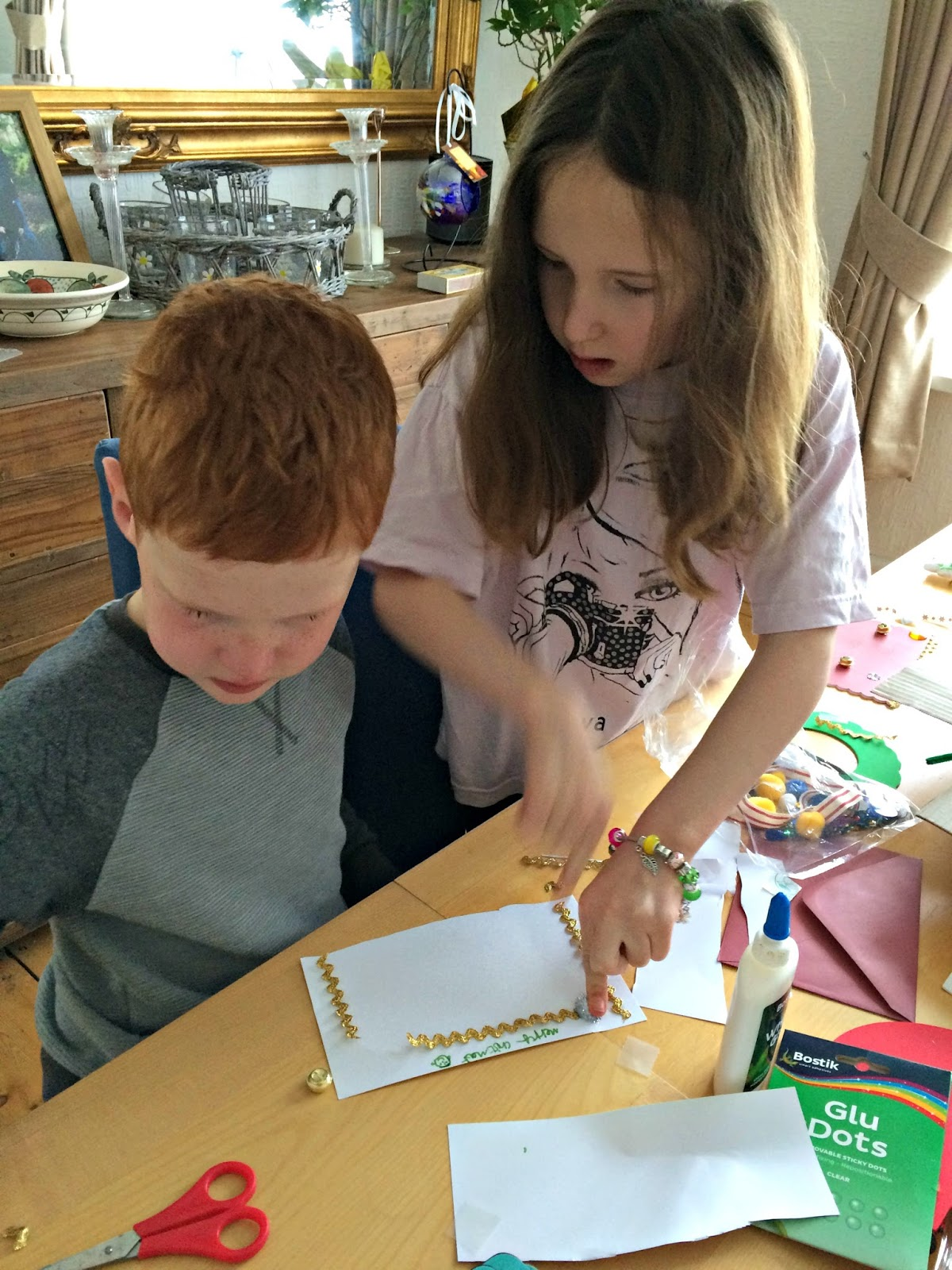 Caitlin & Ieuan making a Christmas card together