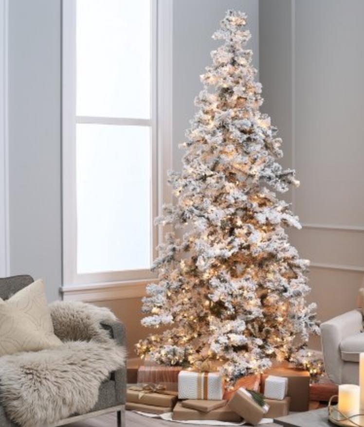 heavily flocked prelit christmas tree