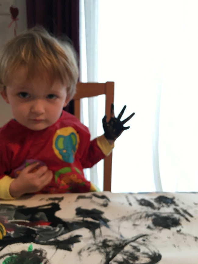 Painting-and-Photography-image-of-toddler-painting-his-hand