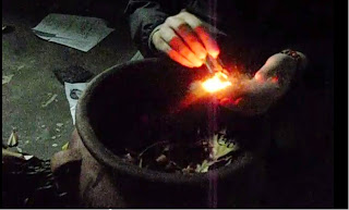 Jack using one of his backup techniques to light a fire
