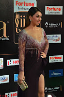 Hansika Motwani in Glittering Deep Neck Transparent Leg Split Purple Gown at IIFA Utsavam Awards 004.JPG