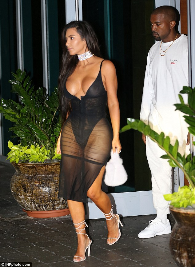 Kim Kardashian wears sheer dress to Kanye's Miami concert