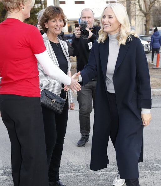 Crown Princess Mette-Marit visited the Fellesverket (Red Cross Youth Activity Centre) in Sandvika. navy wool coat, grey sweater