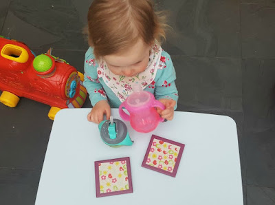 Small child at table with coasters