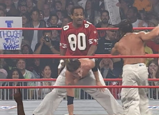 WCW Superbrawl 2000 - Team Package - Norman Smiley does the Big Wiggle on Shane Helms