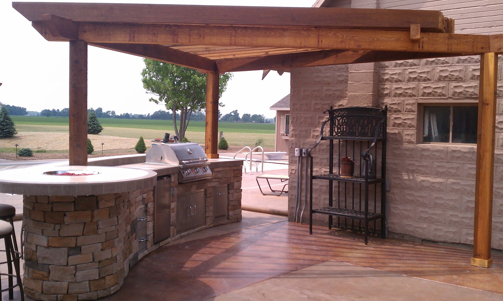 Red Stone Outdoor Kitchen White Marble Countertops Living Radial Pergola