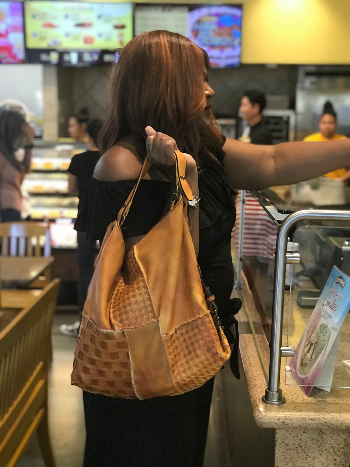 Image: Woman inside of Toll House Cookie Shop Sharing Her Handbag, Top Outfit details on Weekend Bits and Favorites