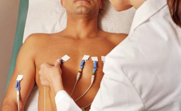 A Man With ECG Leads On His Chest Wall