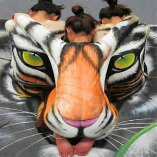 Look deeper !!! What do you see ? Three ladies or a tiger's face ?