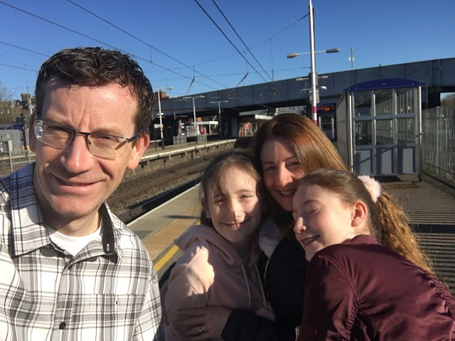 family group photo at train station