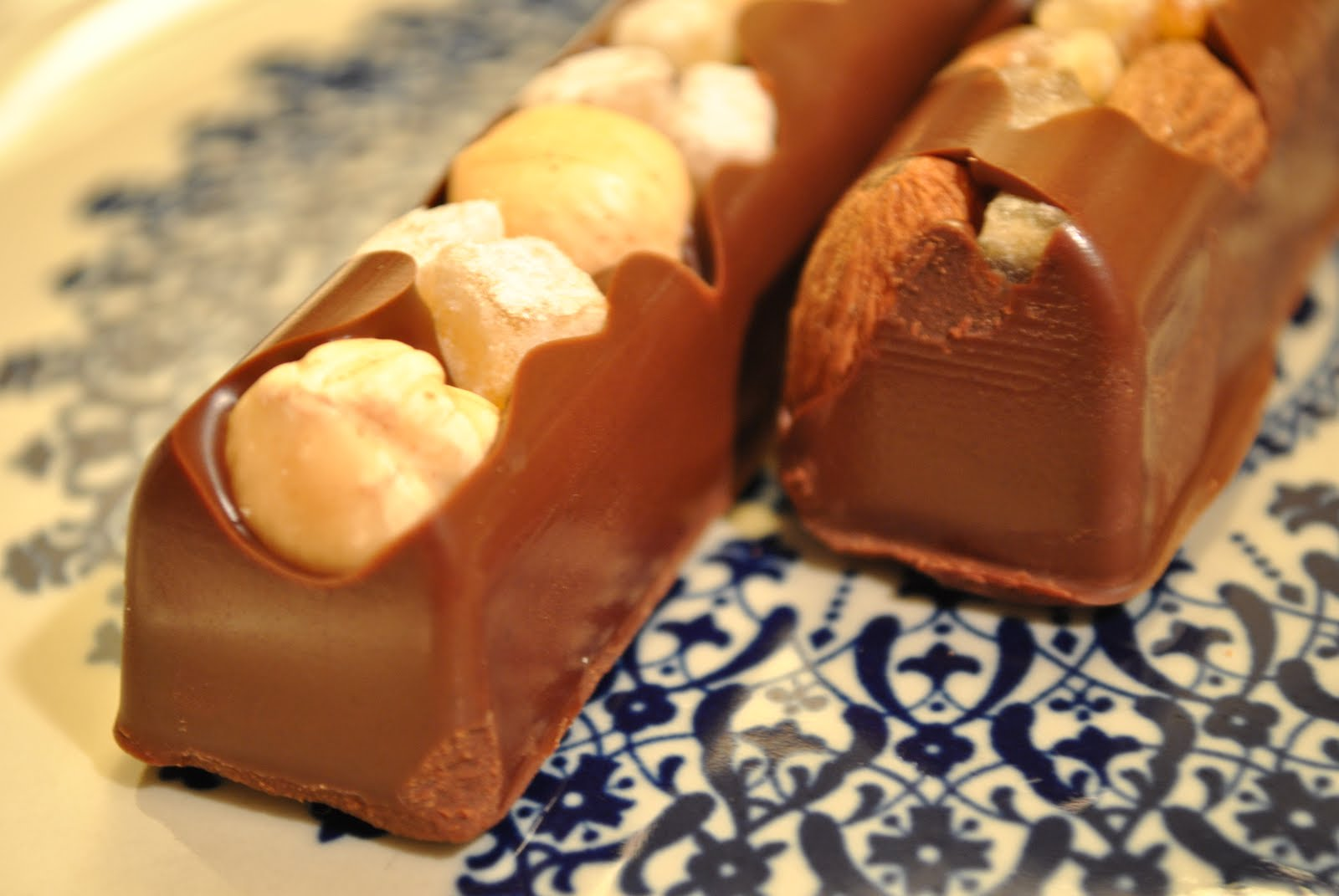 The gianduja base is fantastic. The bars are protected in their own molds,  and you can clearly see where the chocolate was poured in, sometimes to the  point ...