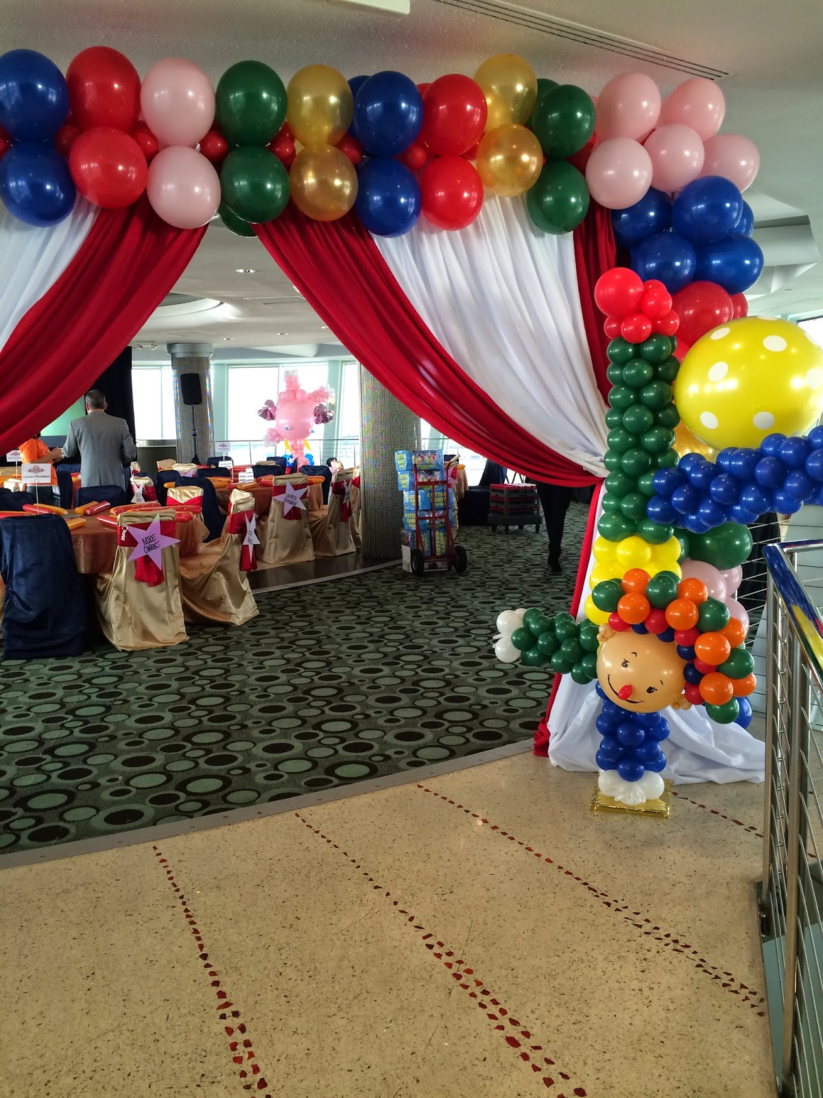 Circus party entrance decoration with draping and clown
