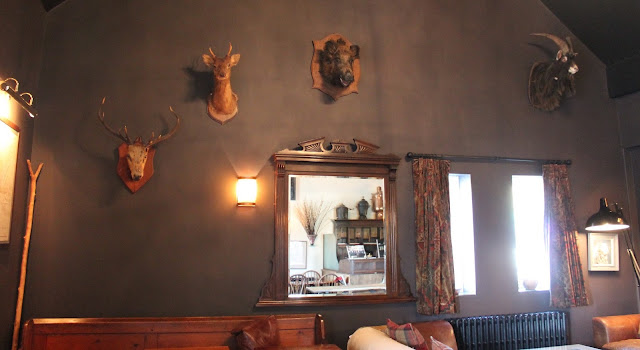 bar area at The Hardwick Hotel in Abergavenny rustic setting with animal heads on wall