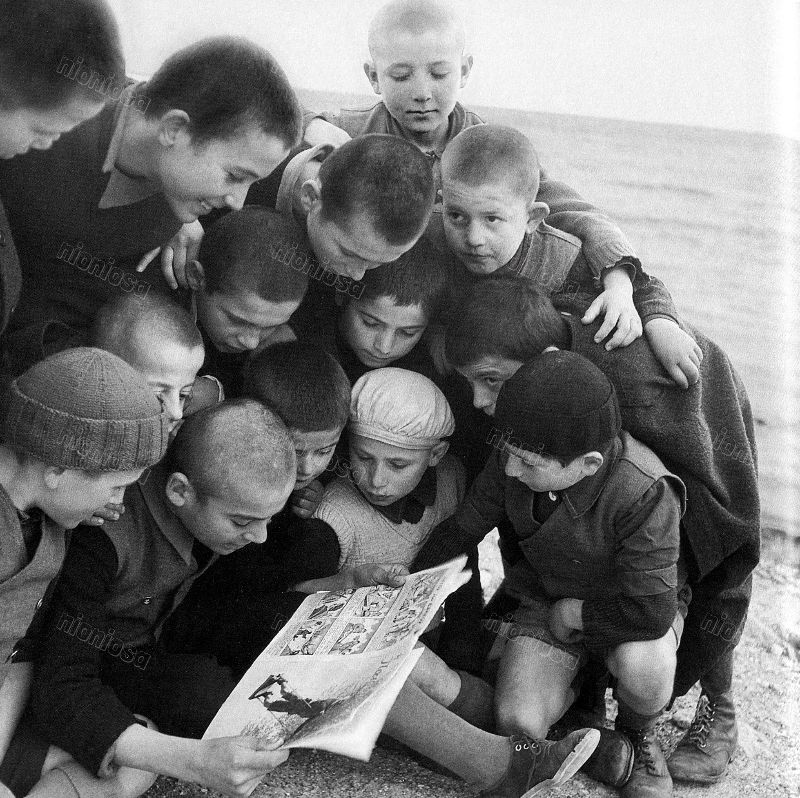 Boys reading a comic book 1950
