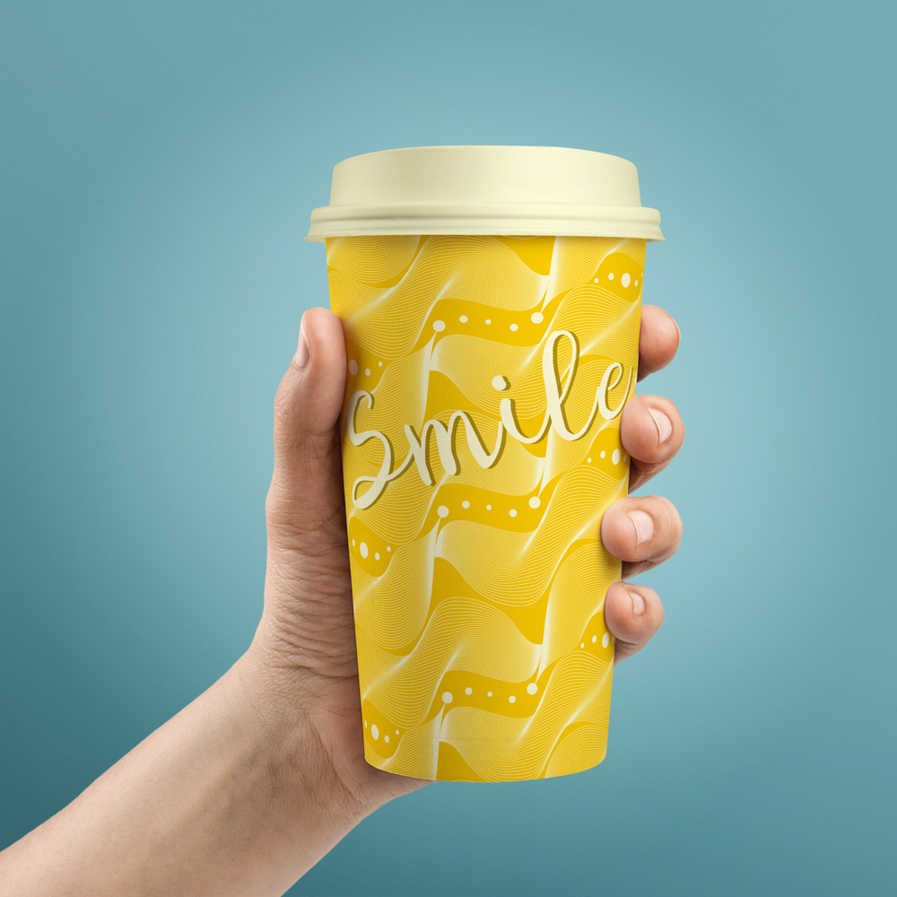 Bright coffee cup with sunny yellow pattern