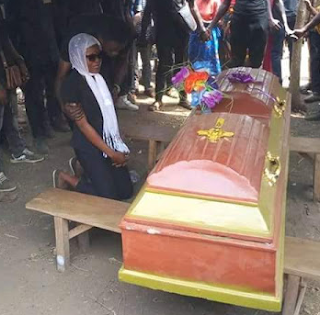 Photos: Heartbroken girlfriend kneels before coffin of her Ebonyi State University student boyfriend to pay her last respect
