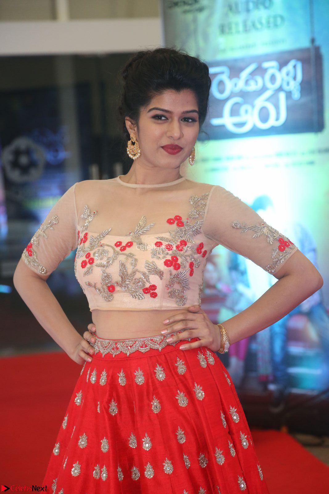 Mahima in beautiful Red Ghagra beigh transparent choli at Rendu Rellu Aaru music launch ~ CelebsNext Exclusive