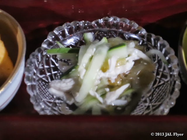 JAL First Class Japanese appetizer: thin-sliced cucumber, jellyfish & chicken in citrus vinegar sauce