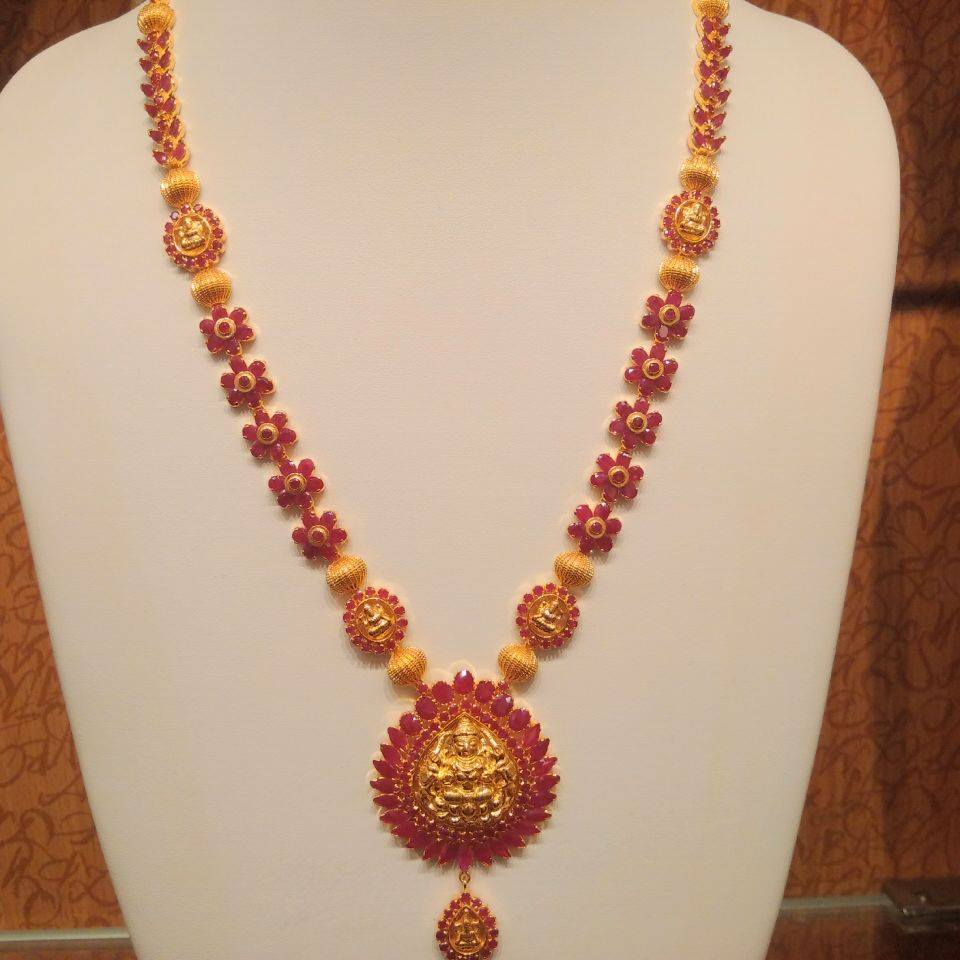 And contemporary gold jhumkas collection by khazana jewellery - 22k Gold Lakshmi Ruby Haram With Temple Work And Floral Design By Naj Jewellers