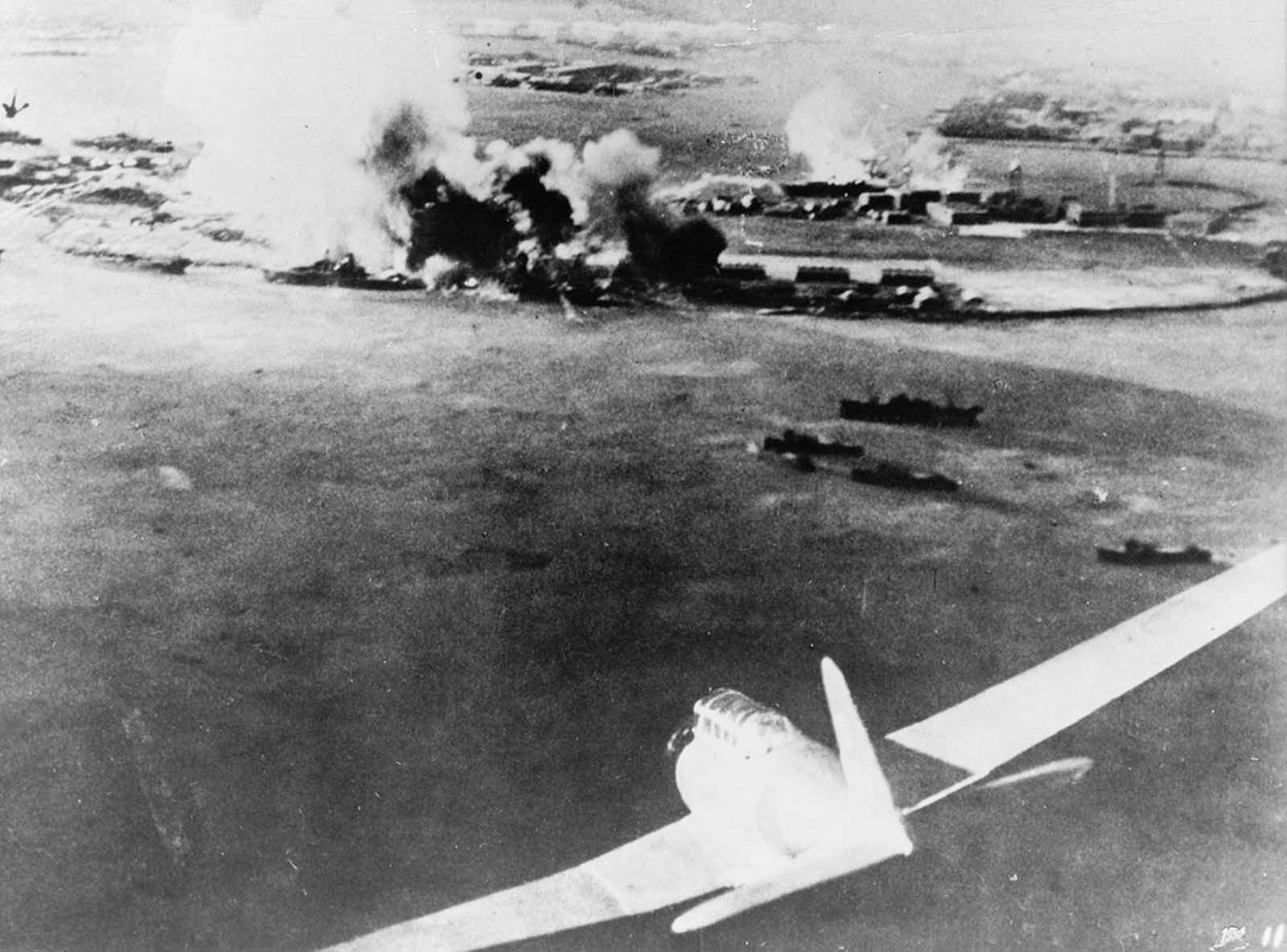 Aerial photograph, taken by a Japanese pilot, of the attack on Pearl Harbor, a Japanese bomber in lower-right foreground.