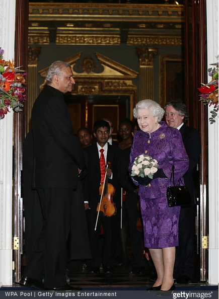 Queen Elizabeth II stands with Commonwealth Secretary-General Kamalesh Sharma during a reception to mark Commonwealth Day at Marlborough House
