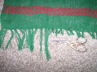 Trimming fringe on woven runner.