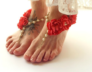 http://www.mojosfreespirit.com/collections/wedding-sandals/products/floral-barefoot-sandals-bridesmaids-flower-color-options-ivory-pearl