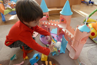 Boy playing with vintage My Little Ponies