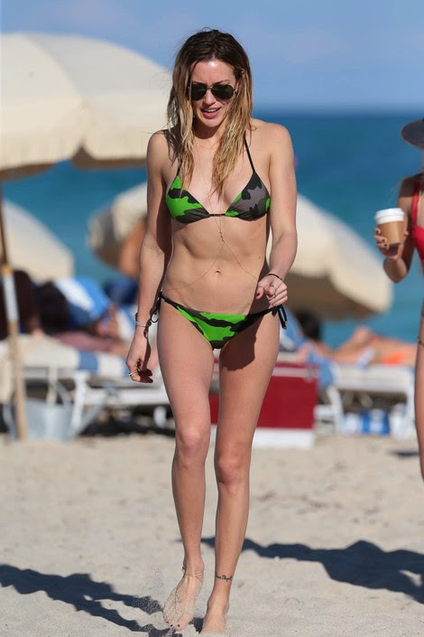 Katie Cassidy flaunts toned abs in camouflage bikini in Miami