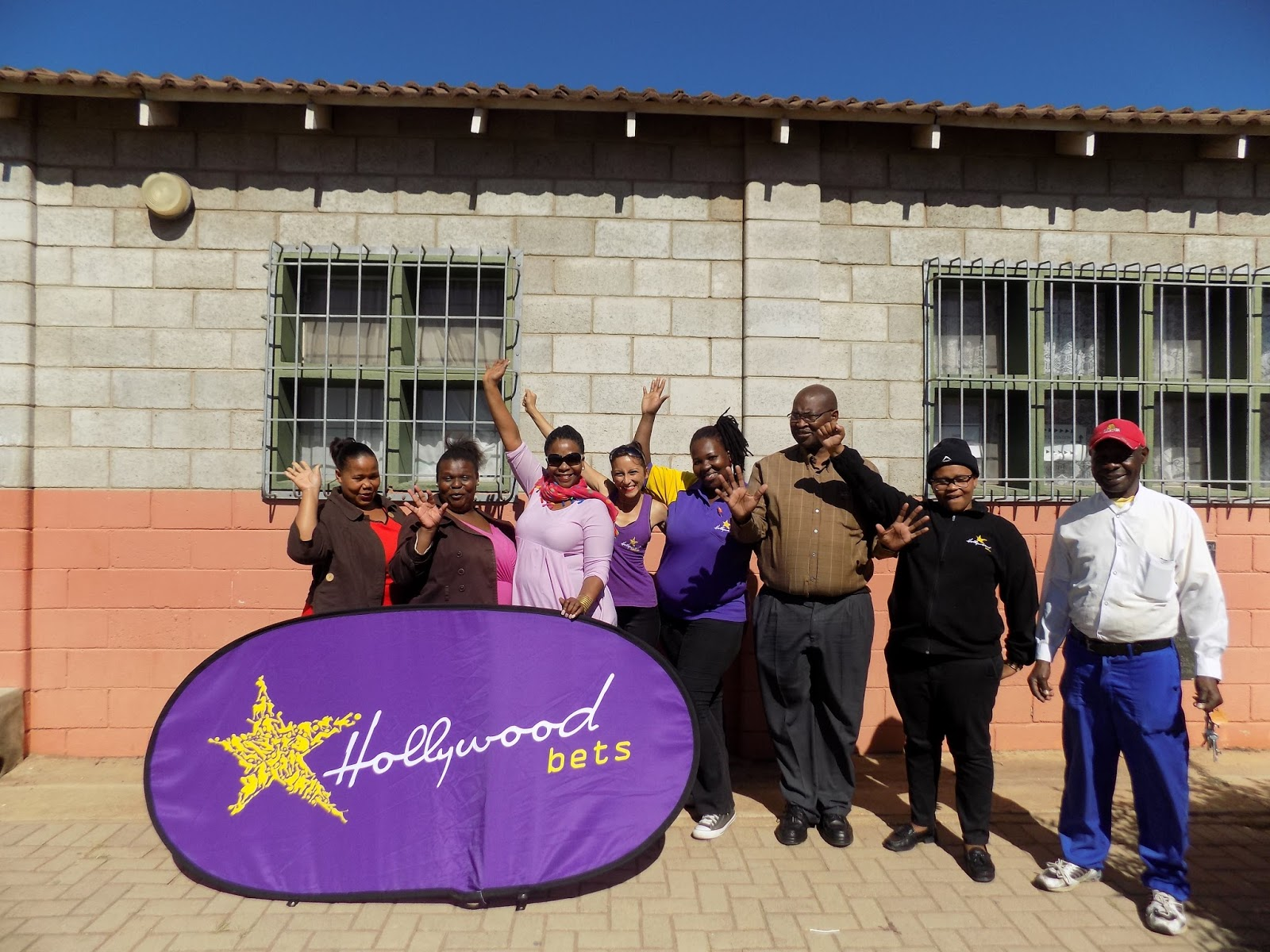 Thubelihle Secondary School staff members are happy to receive a window, doors and door frame from Hollywoodbets Govan Mbeki