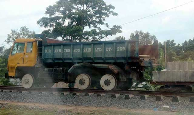The truck is running on the rail line
