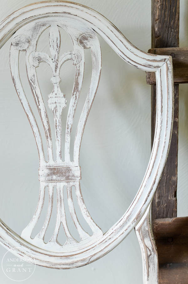 Carved back on a vintage dining room chair.  |  www.andersonandgrant.com