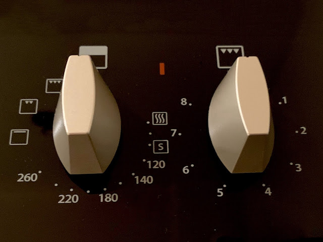2 silver coloured controls for top oven