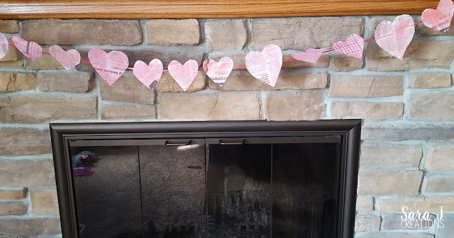 An easy newspaper heart banner craft. Perfect for #valentinesday or #february #crafts #hearts