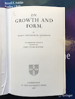 On Growth and Form, by D'Arcy Wentworth Thompson, superimposed on the cover of Intermediate Physics for Medicine and Biology.